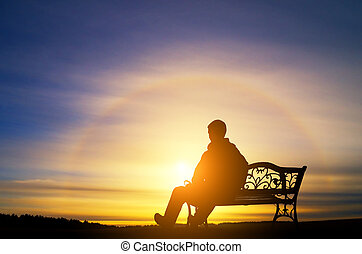 Lonely man sits on a decline - The lonely man sits on a ...