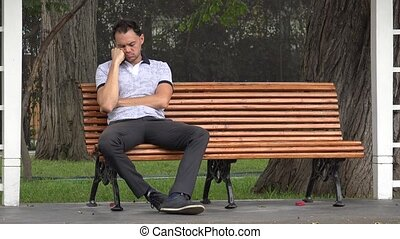 Lonely Man Sitting Alone