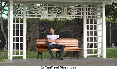 Lonely Man Sitting On Park Bench