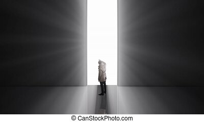 Lonely man standing in front of the huge gate
