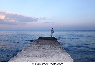 Lonely man watching the sunset on the pier - Lonely man...
