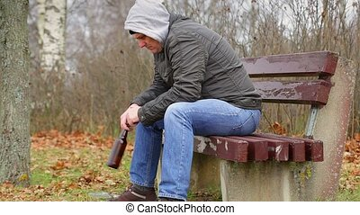 Lonely man with beer bottle