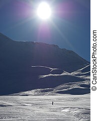 lonely off piste skier - a lone skier skis in fresh powder...