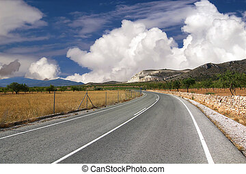 lonely road with beautiful sky in the background