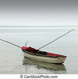 Lonely row boat - A lonely rowboat on calm seas against...