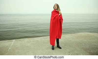 Lonely sad girl in red blanket