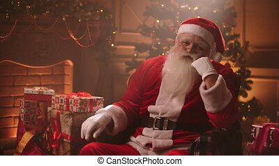 lonely Santa Claus is boring in his room at Xmas evening, celebrating alone in his residence, fairytale and wonder mysterious at winter holidays