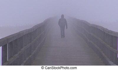 lonely schoolboy walking on bridge - lonely schoolboy...