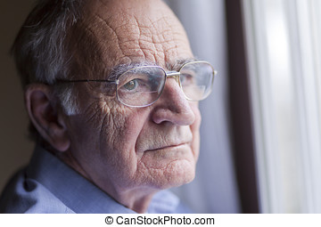 Lonely senior man at the window