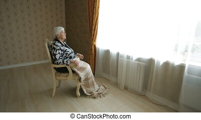 Lonely Senior Woman Look Thru Window - Lonely old woman...