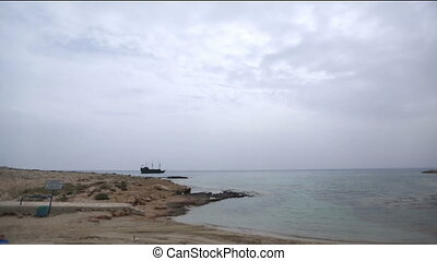 Lonely ship sailing in the beautiful Cyprus seashore.