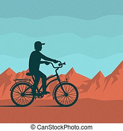 cyclist on a background of red mountains