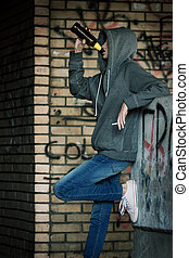 Lonely Teenager Girl Sitting and Smoking  Cigarette in Doorway