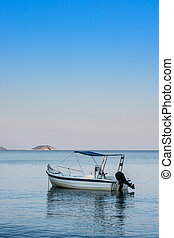 Lonely traditional greek fishing boat on sea water