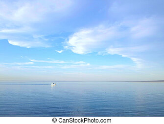 Lonely white boat at the calm sea