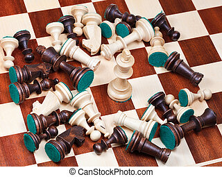 white king and scattered chess pieces