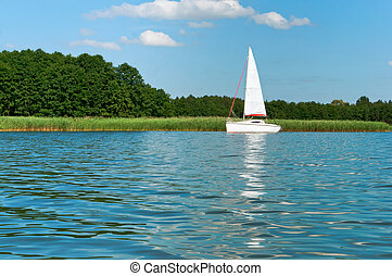lonely white yacht, one yacht on the lake in summer, one yacht with white sails