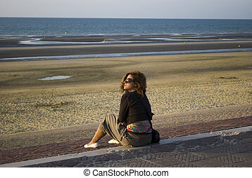 Lonely woman at seaside