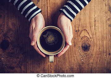 Lonely woman drinking coffee in the morning, top view of...