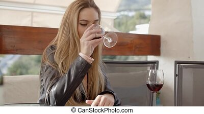 Lonely woman drinking wine