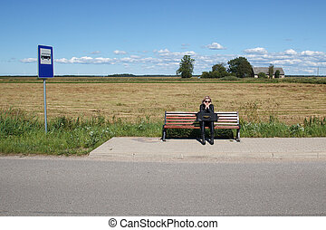 lonely woman in bus stop