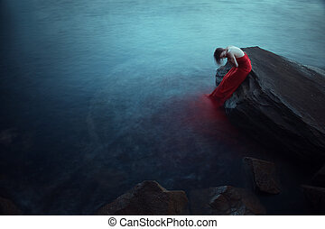 Lonely woman near the sea