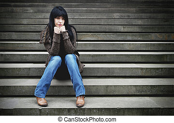 lonely woman sitting on steps