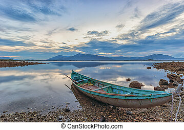 Lonely, wooden boat in the lake