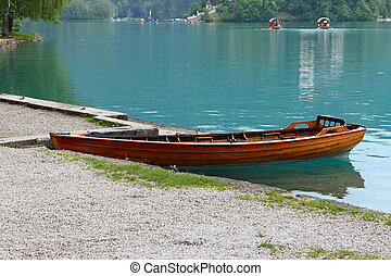 Lonely wooden boat on lake Bled, Slovenia