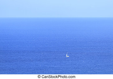 Lonely yacht against the blue sea in Antalya