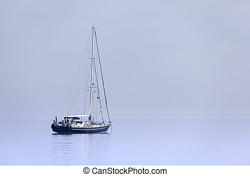 Lonely yacht in calm blue sea