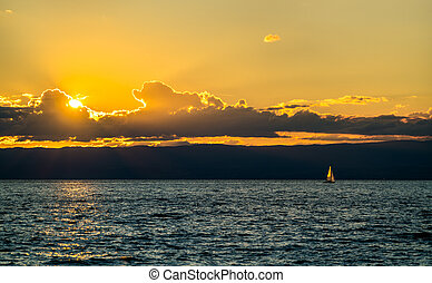 Lonely yacht on Lake Geneva at sunset in Switzerland