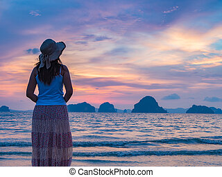 Lonely young woman on the beach, sad concept.
