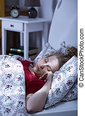 Lonely young woman sleeping