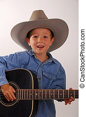 Lonesome Cowboy Nine - Young boy playing guitar