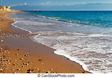 Long and inviting sandy beach in the Mediterranean without...