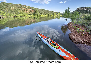 Long and narrow racing stand up paddleboard on a calm ...