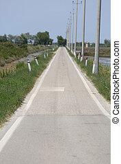 long asphalt road in the plain