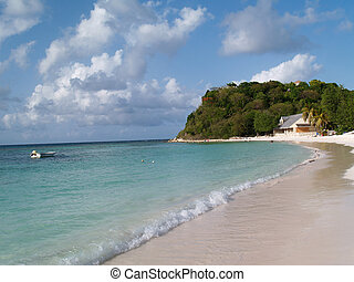 Long Bay beach off the Atlantic Ocean on Antigua Barbuda in the Caribbean Lesser Antilles West Indies.