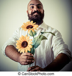 long beard and mustache man giving flowers