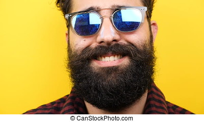 Long bearded men with sunglasses on smiling - Slow motion of...
