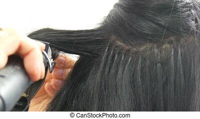 Long beautiful black hair curler stylist curls. Hair styling...