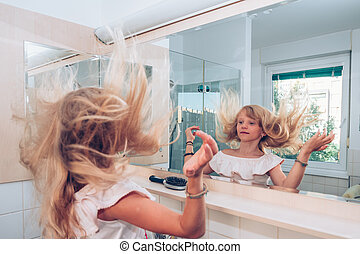 long blond hair flying in the air in the bathroom