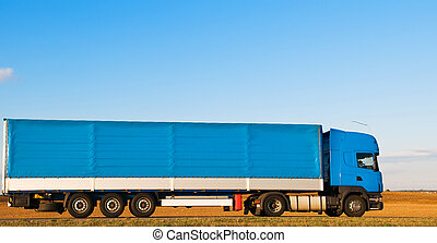 Long blue truck on highway