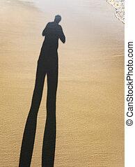 long body shadow of a man