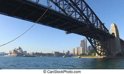 A wide shot of a long bridge and city.