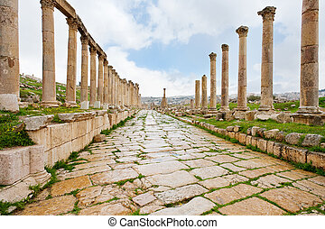 long colonnaded street or cardo in antique town Jerash in Jordan