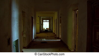 Long corridor in an abandoned house.