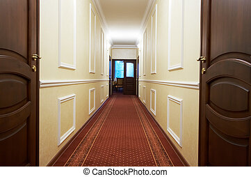 Long corridor with a window in modern hotel