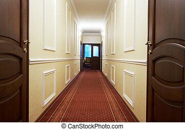 long corridor - Long corridor with a window in modern hotel